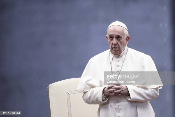 Pope Francis prays on the sagrato of St. Peter's Square to deliver a special Urbi et Orbi Blessing to the world, on March 27, 2020 in Vatican City,...