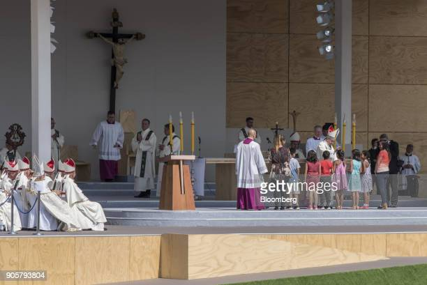 Pope Francis prays over a group of children during a mass at O'Higgins Park in Santiago Chile on Tuesday Jan 16 2018 400000 Chileans attended Pope...