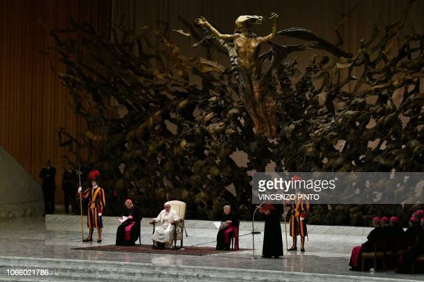 Pope Francis Prefect of the Papal Household Georg Ganswein and Cardinals attend the weekly general audience on November 28 2018 in Paul VI hall at...