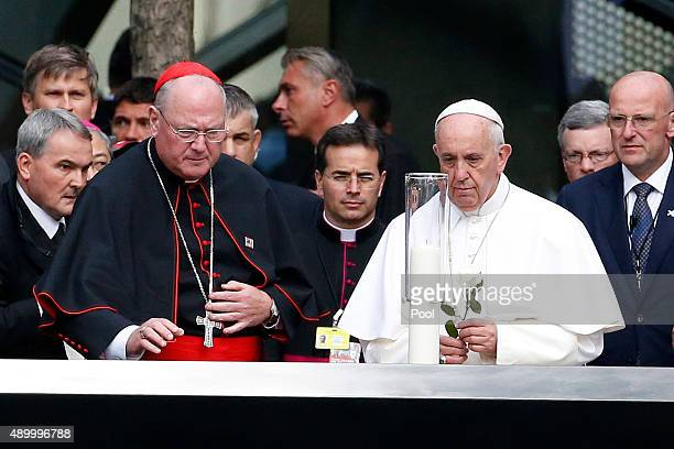 Pope Francis prepares to lay a flower on the edge of the South Pool at the World Trade Center on September 25 2015 in New York City The Pope is on a...