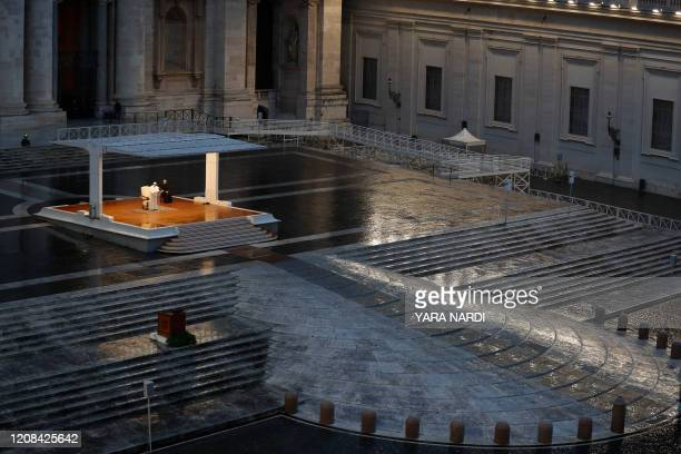 TOPSHOT Pope Francis presides over a moment of prayer on the sagrato of St Peters Basilica the platform at the top of the steps immediately in front...