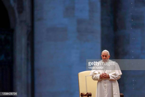Pope Francis presides over a moment of prayer on the sagrato of St Peters Basilica the platform at the top of the steps immediately in front of the...