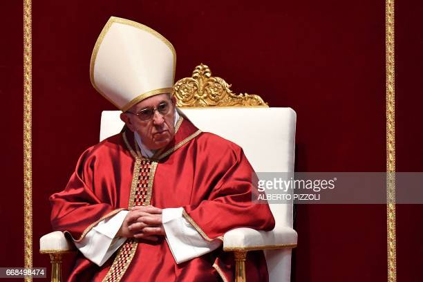 Pope Francis presides the Celebration of the Lord's Passion on Good Friday at St Peter's basilica on April 14 2017 in Vatican Christians around the...
