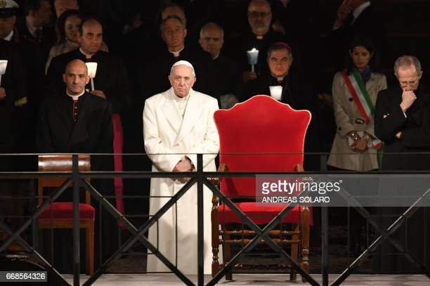 Pope Francis presides the Via Crucis torchlight procession at the Colosseum on Good Friday on April 14 2017 in Rome Christians around the world are...