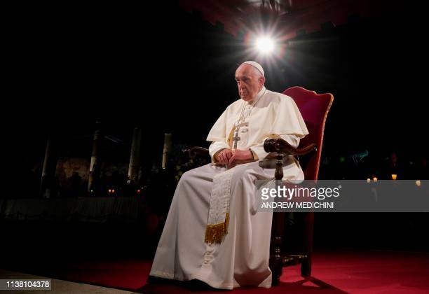 Pope Francis presides the Via Crucis torchlight procession at the ancient Colosseum on Good Friday, on April 19, 2019 in Rome.