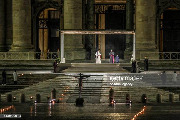 Pope Francis presides the Via Crucis torchlight procession to commemorate the crucifixion of Jesus Christ in St Peter's Square at the Vatican on Good...