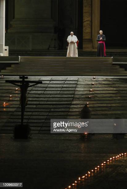 Pope Francis presides the Via Crucis torchlight procession to commemorate the crucifixion of Jesus Christ, in St. Peter's Square at the Vatican on...