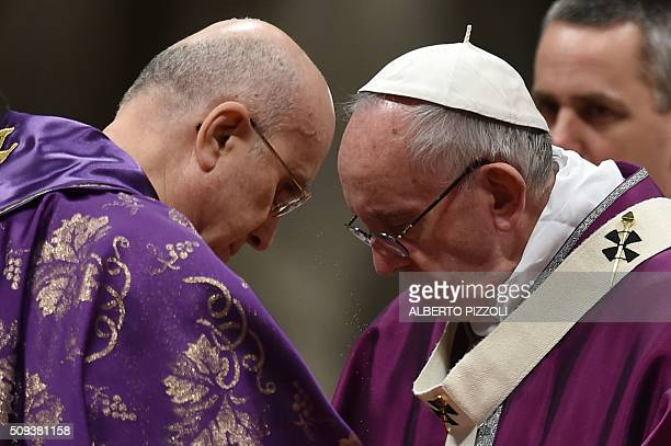 Pope Francis puts ashes on the head of Cardinal Bertone during the Ash Wednesday mass opening Lent the fortyday period of abstinence and deprivation...