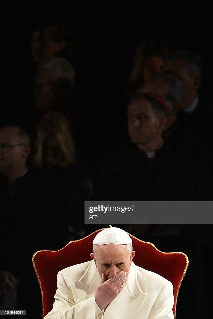 Pope Francis reacts during the Way of the Cross on Good Friday on March 29, 2013 at the Colosseum in Rome. Pope Francis presided over his first Good Friday which will culminate in a torch-lit procession at Rome's Colosseum and prayers for peace in a Middle East 'torn apart by injustice and conflicts'.