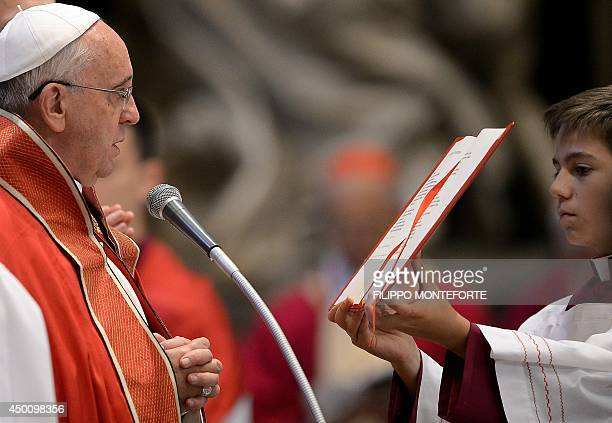 Pope Francis reads from a prayer book during the funeral ceremony for late Indian Cardinal D Simon Lourdusamy in Saint Peter's Basilica at the...