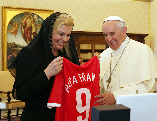 Pope Francis receives a Croatian national team football shirt with his name on it as a gift from President of Croatia Kolinda Grabar-Kitarovic and...
