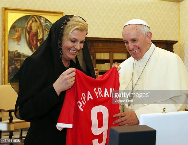 Pope Francis receives a Croatian national team football shirt with his name on it as a gift from President of Croatia Kolinda GrabarKitarovic and her...