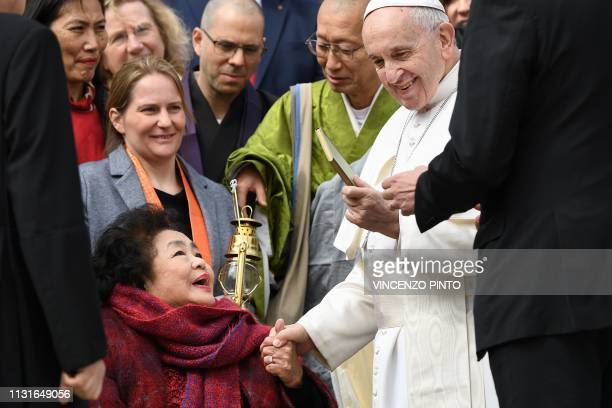 Pope Francis receives a gift from JapaneseCanadian nuclear disarmament campaigner and 'Hibakusha' who survived the atomic bombing of Hiroshima on...