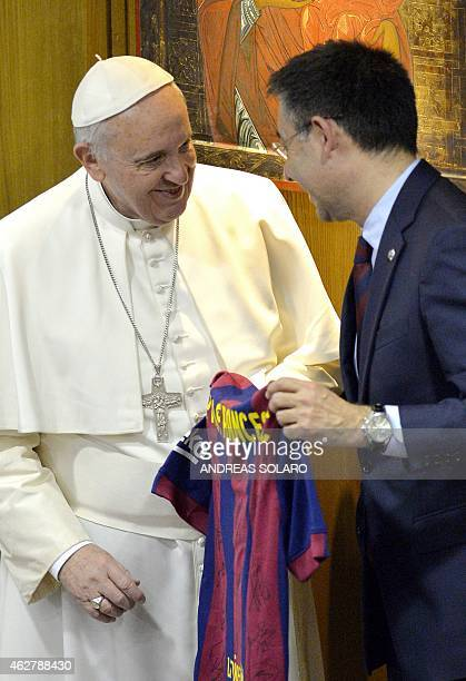 Pope Francis receives a jersey from FC Barcelona club president Josep Maria Bartomeu after a video conference to mark the end of the IV Scholas...
