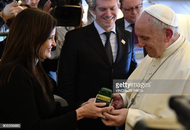Pope Francis receives a model of the truck used by Chilean priest Father Hurtado canonized in 2005 by Pope Benedict XVI as a gift as he welcomes...