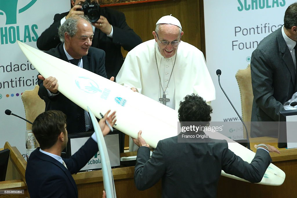 Pope Francis receives a surf board during 'Un Muro o Un Ponte' Seminary held by Pope Francis at the Paul VI Hall on May 29, 2016 in Vatican City, Vatican.