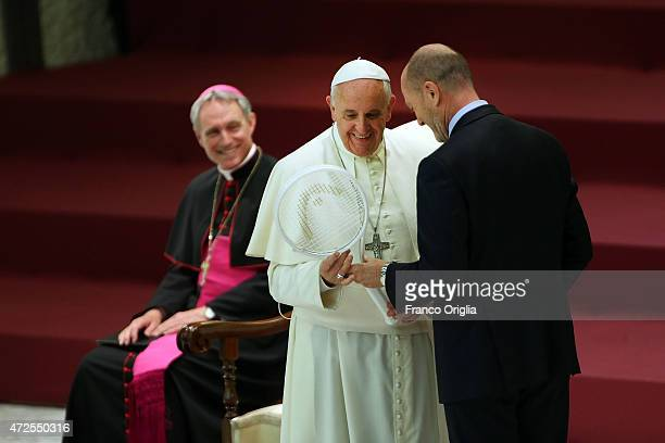 Pope Francis receives a tennis racket from President of the Italian Tennis Federation during an audience at the Paul VI Hall on May 8 2015 in Vatican...