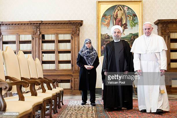 Pope Francis receives in audience President of Iran Hassan Rouhani at his private library in the Apostolic Palace on January 26 2016 in Vatican City...