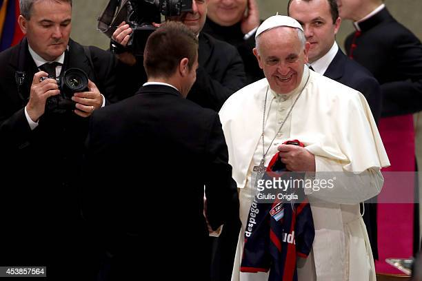 Pope Francis receives the San Lorenzo jersey from Julio Alberto Buffarini as he meets members of the San Lorenzo football team during his weekly...
