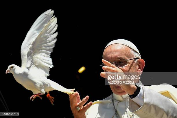 Pope Francis releases a dove after a meeting with other religious leaders at the Pontifical Basilica of St Nicholas in Bari in the Apulia region in...