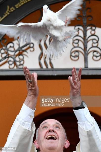 Pope Francis releases a dove as a symbol of peace during a meeting with Chaldean community at the Catholic Church of St Simon Bar Sabbae in Tbilisi...