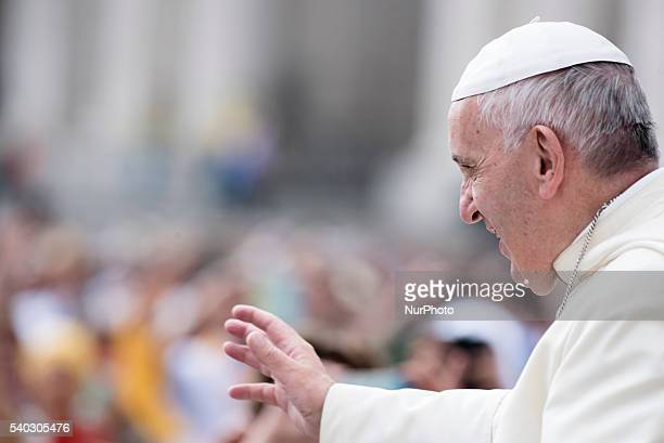 Pope Francis salutes the faithful as he arrives for his weekly general audience in St Peter's Square at the Vatican Wednesday June 15 2016