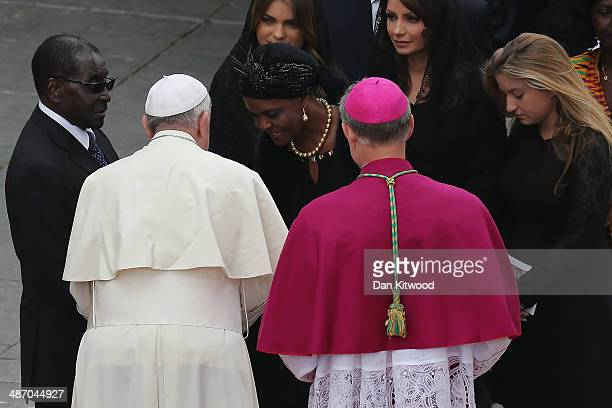 Pope Francis salutes Zimbabwe's President Robert Mugabe and his wife Grace after the canonisation in which John Paul II and John XXIII were declared...
