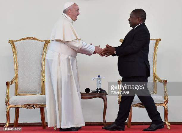 Pope Francis shakes hands after Mozambique President Filipe Nyusi speech during a meeting with the authorities, the civil society and the diplomatic...
