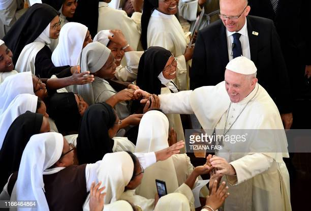 Pope Francis' shakes hands to nuns at the end of the morning prayer at the Monastery of the Discalced Carmelites in Antananarivo Madagascar on...