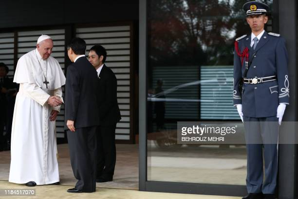 Pope Francis shakes hands with Emperor Naruhito as he leaves after a meeting at the Imperial Palace in Tokyo on November 25 2019 Pope Francis called...
