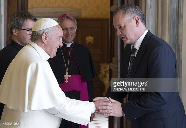 Pope Francis shakes hands with Slovak President Andrej Kiska during a private audience in the pontiff's studio at the Vatican on April 9 2015 AFP...