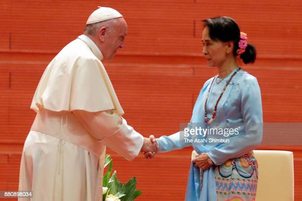 Pope Francis shakes hands with State Counsellor Aung San Suu Kyi listens on November 28 2017 in Nay Pyi Taw Myanmar