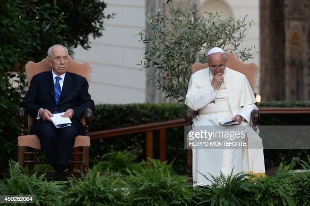 Pope Francis sits between Palestinian leader Mahmud Abbas and Israeli President Shimon Peres during a joint peace prayer on June 8 2014 in the...