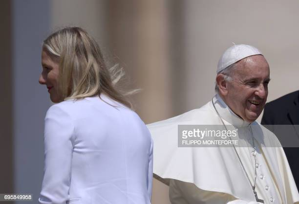 Pope Francis smiles after meeting Canada's Environment Minister Catherine McKenna St Peter's Square at the Vatican on June 14 2017 / AFP PHOTO /...