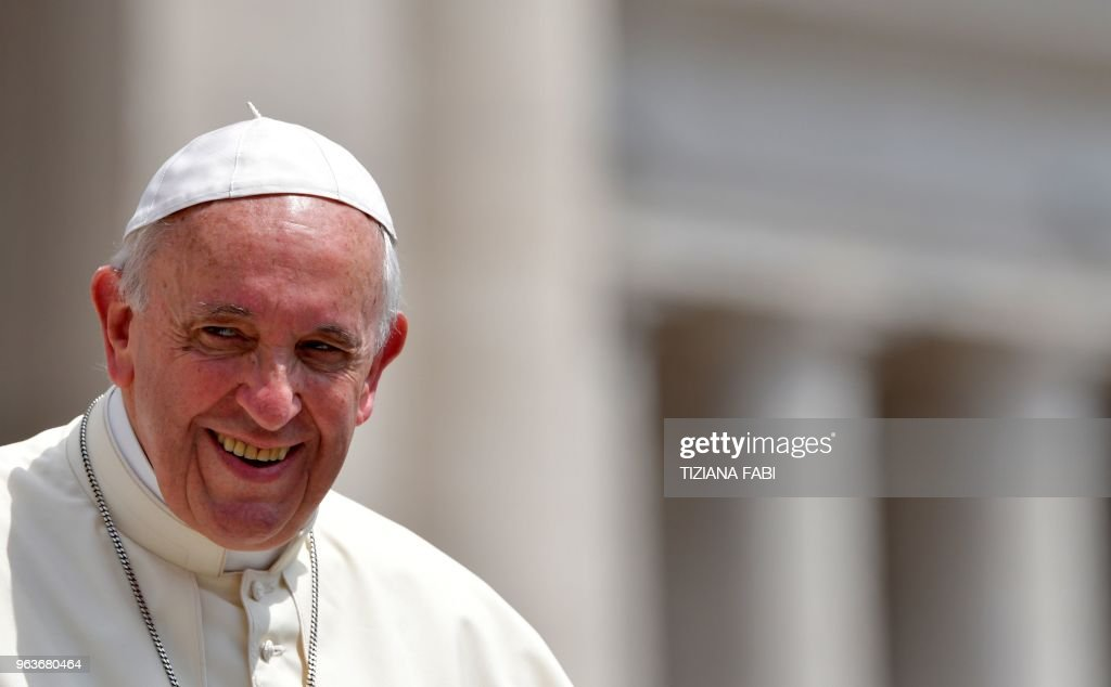 Pope Francis smiles as he leaves at the end of his weekly general audience in Saint Peter's Square at Vatican on May 30, 2018.