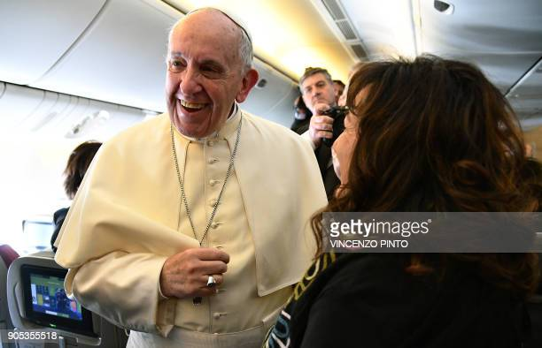 Pope Francis smiles as he welcomes journalists on board the plane on the way to Santiago at the start of his sevenday trip to Chile and Peru on...