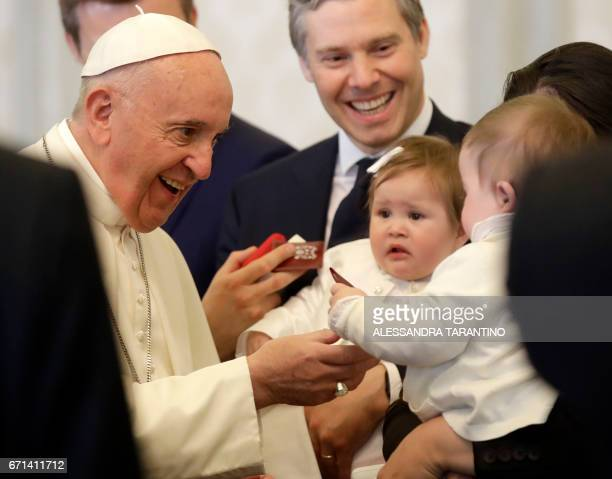 Pope Francis smiles to babies part of the delegation of Hereditary Prince Alois of Liechtenstein on the occasion of their private audience on April...
