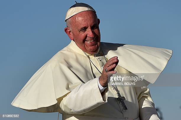 TOPSHOT Pope Francis smiles upon arrival at the US border before celebrating mass at the Ciudad Juarez fairgrounds on February 17 2016 Throngs...