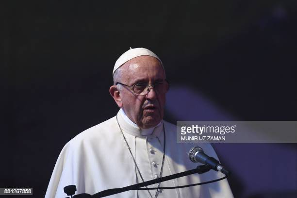 Pope Francis speaks during a meeting with young people at Notre Dame College in Dhaka on December 2 2017 Pope Francis arrived in Bangladesh from...