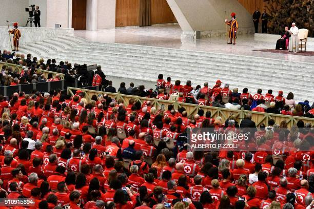 Pope Francis speaks during an audience with members of the Italian Red Cross and Red Crescent in the Paul VI hall at the Vatican on January 27 2018 /...