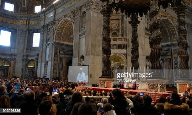 Pope Francis speaks during his weekly audience in St Peter's Basilica at the Vatican on February 28, 2018. / AFP PHOTO / TIZIANA FABI