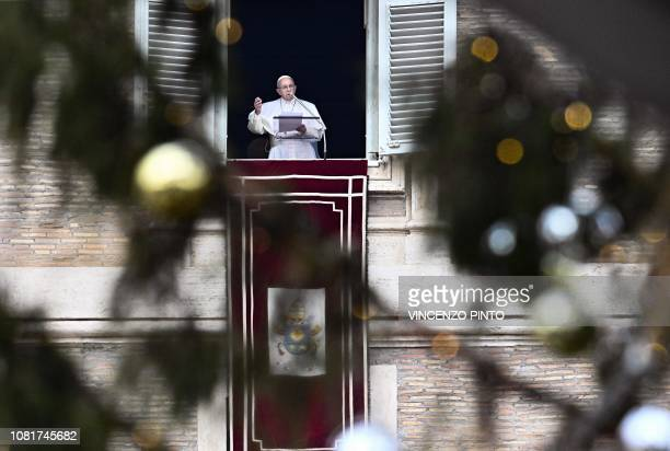 Pope Francis speaks from the window of the Apostolic Palace overlooking St Peter's square in the Vatican during the weekly Angelus prayer on January...