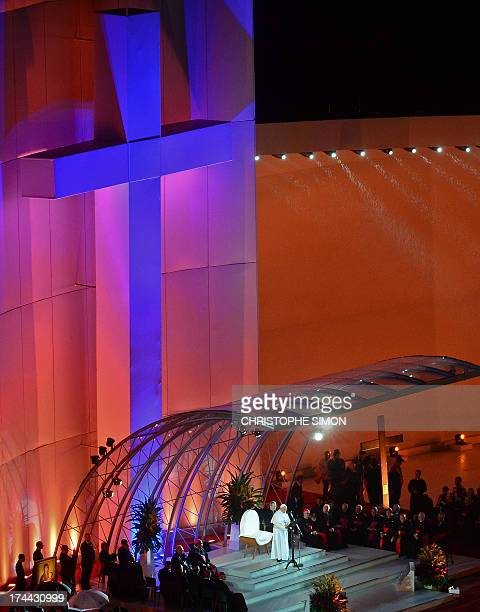 Pope Francis speaks on the stage at Rio de Janeiro's iconic Copacabana beachfront on July 25 2013 during the welcoming ceremony offered to him by the...