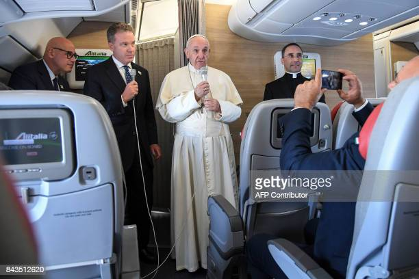 Pope Francis speaks to journalists aboard a flight from Italy to Colombia on September 6 2017 Pope Francis set off for Colombia on Wednesday for a...