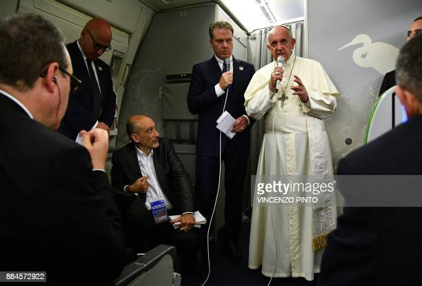 Pope Francis speaks to reporters during a news conference on board of a plane on December 2 during a flight back from a sevenday trip to Myanmar and...