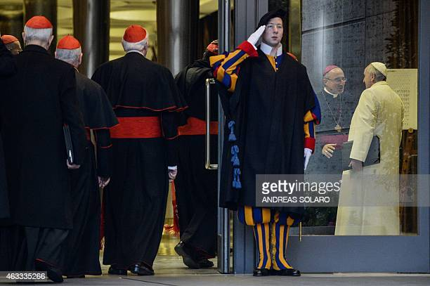 Pope Francis speaks with Patriarch of Lisbon in Portugal Manuel José Macário do Nascimento Clemente as he arrives to take part with cardinals and...
