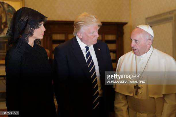 Pope Francis speaks with US President Donald Trump and US First Lady Melania Trump during a private audience at the Vatican on May 24 2017 US...