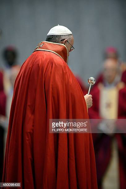 Pope Francis spreads holy water on the coffin during the funeral ceremony for late Indian Cardinal D Simon Lourdusamy in Saint Peter's Basilica at...