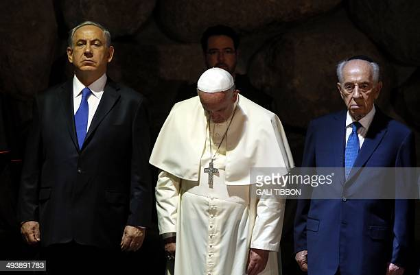 Pope Francis stands alongside Israeli President Shimon Peres and Israeli Prime Minister Benjamin Netanyahu at the Hall of Remembrance on May 26...