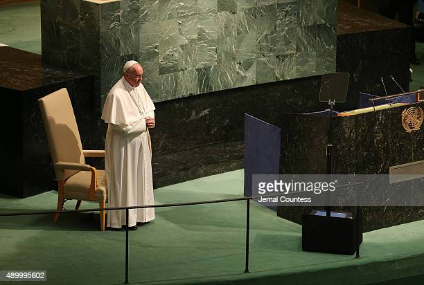 Pope Francis stands before the audience at the UNited Nations General Assembly after his address to The United Nations General Assembly on September...